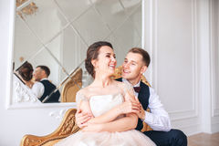 Wedding couple on the studio. Wedding day. Happy young bride and groom on their wedding day. Wedding couple - new family. Stock Photography