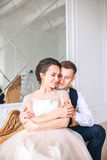 Wedding couple on the studio. Wedding day. Happy young bride and groom on their wedding day. Wedding couple - new family. Royalty Free Stock Image