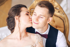 Wedding couple on the studio. Wedding day. Happy young bride and groom on their wedding day. Wedding couple - new family. Royalty Free Stock Photos