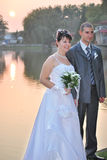Wedding couple on sunset. Groom and bride on sunset near lake Stock Images