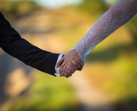 Wedding couple together holding their hands, hands close up Royalty Free Stock Photos