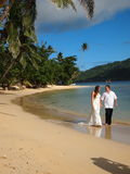 Wedding Couple Trashing The Dress on Beach in Fiji Royalty Free Stock Images