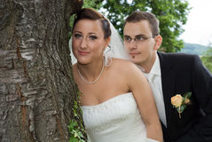 Wedding Couple with tree. Portrait of a wedding couple leaning against a tree Stock Images