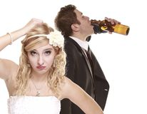 Wedding couple, unhappy bride with alcoholic groom Stock Images
