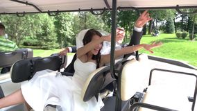Wedding couple in vehicle. stock video footage