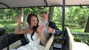 Wedding couple in a vehicle. stock footage