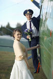 Wedding couple in vintage aircraft Royalty Free Stock Photo
