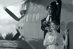 Wedding couple in vintage aircraft Stock Photos