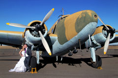 Wedding couple with vintage airplane Stock Photo