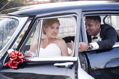 Wedding couple with a vintage car Royalty Free Stock Photos