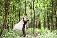 Wedding couple on a walk Royalty Free Stock Image