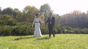 Wedding couple at a walk in the park. Moving and emotional moment. stock video