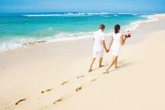 Wedding couple. Couple walking on the beach, bali Royalty Free Stock Photography