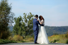 Wedding couple walking. Bride and groom walking at the mountains Royalty Free Stock Photo