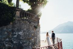 Wedding couple walking on Como Lake, Varenna royalty free stock photography