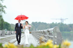 Wedding couple walking by the embankment Royalty Free Stock Photos