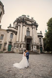 Wedding couple walking. In Lviv architecture Royalty Free Stock Photos