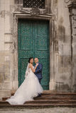 Wedding couple walking. In Lviv architecture Royalty Free Stock Photography