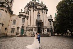 Wedding couple walking. In Lviv architecture Stock Photo
