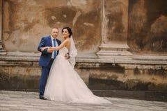 Wedding couple walking. In Lviv architecture Stock Photos