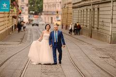 Wedding couple walking. In Lviv architecture Stock Images