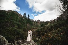 Wedding couple walking near the lake in Tatra mountains in Poland. Morskie Oko. Beautiful summer day royalty free stock photo