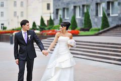 Wedding couple walking in an old town Royalty Free Stock Photos