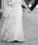 Wedding couple walking street Royalty Free Stock Photo