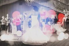 Wedding couple waltz, bokeh effect Stock Images