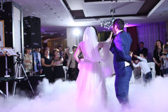 Wedding couple waltz. With party smoke and lights stock photo