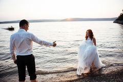 Wedding couple in the water at sunset Royalty Free Stock Image