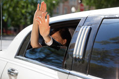 Wedding Couple Wave from Limo Royalty Free Stock Images