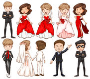 Wedding couples in different costumes Stock Images
