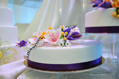 Wedding cake glazed with white chocolate stock image