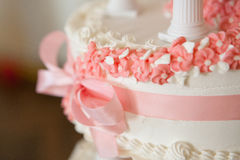 Wedding cream pink cake. Wedding cream cake,pink bows, flowers and bow Stock Image