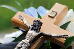 Wedding cross. Detail on the Jesus Christ on the cross with flowers background, focused to Jesus face Stock Images