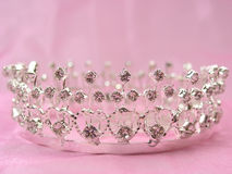 Wedding crown. The wedding diadem lays on a pink fabric Royalty Free Stock Image
