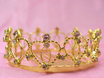 Wedding crown. The wedding diadem lays on a pink fabric Stock Photo