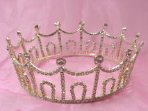 Wedding crown. The wedding diadem lays on a pink fabric Royalty Free Stock Photo