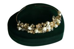 Wedding crystal and pearl diadem of the bride. The diadem of the bride laying on velvet green box and waiting  a bride on wedding ceremony Royalty Free Stock Photo