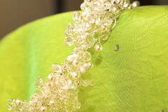 Wedding crystal and pearl tiara. Crystal and pearl hand-made tiara with silver wire on a green silk background Royalty Free Stock Photography