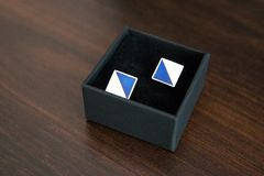 Wedding cufflinks in a blue shade royalty free stock photos
