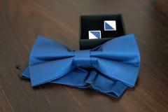 Wedding cufflinks in a blue shade stock photo