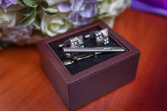 Wedding cufflinks. Wedding rings with bouquet and accessories Stock Photo