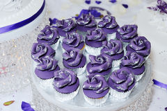 Wedding cup cakes. Purple or violet cup cakes at wedding reception closeup detail Royalty Free Stock Image