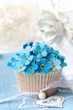 Wedding cupcake. Cupcake decorated with sugar forget-me-nots stock photos