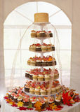Wedding cupcake cake. Wedding cake of cupcakes with autumn leaves at reception Royalty Free Stock Image