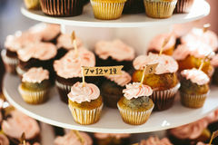 Wedding Cupcake Display. Pink raspberry buttercream cupcakes on a display at a wedding reception Royalty Free Stock Photo