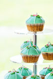 Wedding cupcake tower stand with turquoise cakes. Stock Images