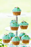 Wedding cupcake tower stand with turquoise cakes. Royalty Free Stock Photo